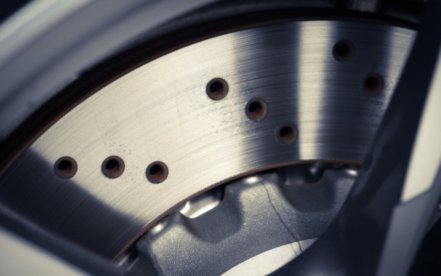 Close-up shot of a car's brake disc.